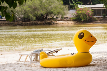 Yellow Duck swim tube on the beach Inflatable duck.Fantasy Swim Ring for Summer sea Trip on the beach at the Koh Samet island, Rayong, Thailand.