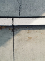 Sidewalk and curb on urban street, close up