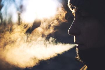 Woman blowing smoke