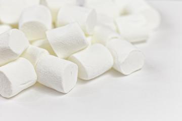 Close up background of many white fluffy marshmallows