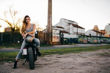 Attractive girl motorcycle rider posing