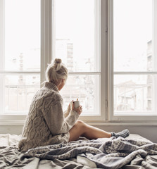 Blonde Woman Drinking Morning Coffee in Bed