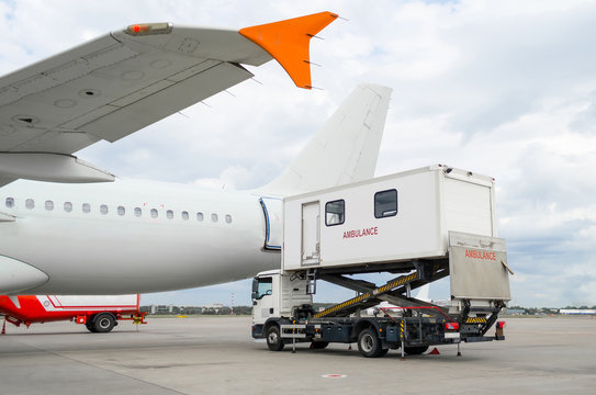 Airplane at the airport with loading ladder for disabled people.