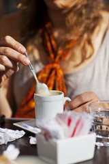 Girl Drinks Cappuccino with Sugar