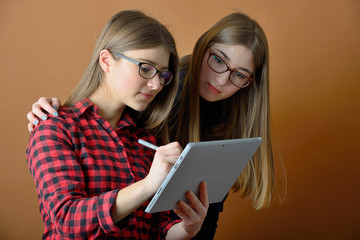 Young teenage girls with a tablet