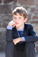 boy in suit waiting