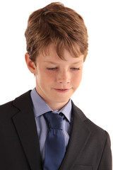 portrait of a boy in suit with tie