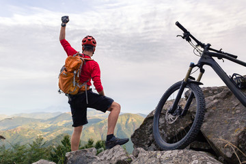 Mountain biker success, looking at inspiring mountains