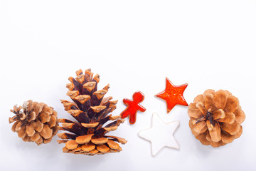 Background Christmas and New year Concept Pine cones and nuts with ceramic decoration  on white background