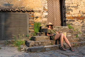 Woman resting on step