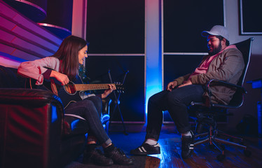 Musicians composing a song in recording studio