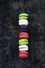 Colorful macaroons on a rustic background