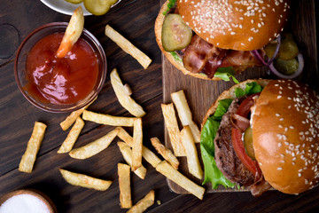 French fries with tomato sauce and hamburger