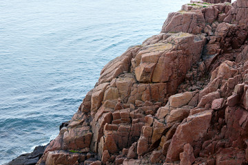 View on the rocky shore of the Barents sea. Kola Peninsula, The Arctic, Russia.