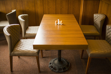 Classical wooden dining table and leather dining chairs