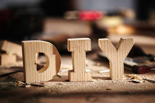 DIY written on a workshop table