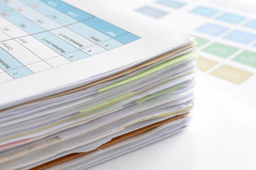 Stack of documents on desk at workplace,business concept.