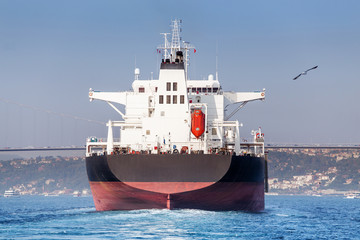 Stern of a large tanker cargo ship on route to Bosporus strait in Black sea. Turkish water transport concept