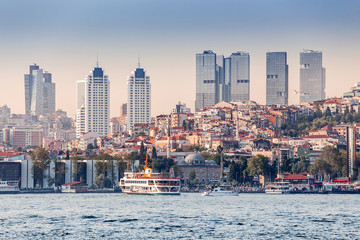 View from the sea cityscape with modern skyscrapers in business center of Istanbul