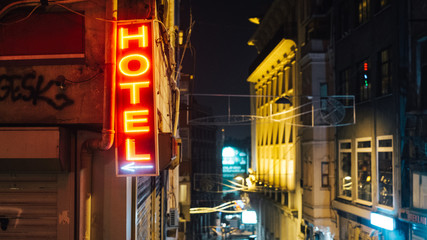 Hotel neon sign pointing left