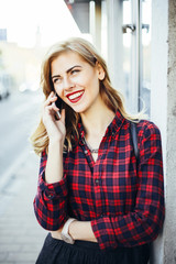 Smiling Blonde Woman Telephoning Outdoors