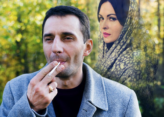 The man smokes and remembers the woman,unfortunate love