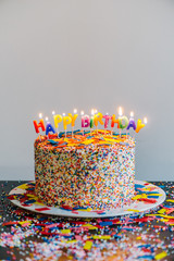 Birthday cake against white background