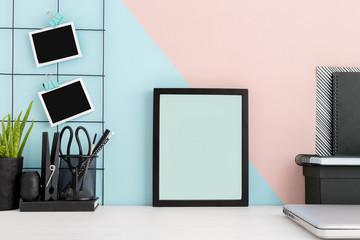Photo frame on a stylish des mock up.