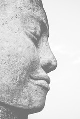 Stone Buddha face statue in Angkor Wat, Cambodia