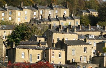 terraced houses set in trees in hebden bridge
