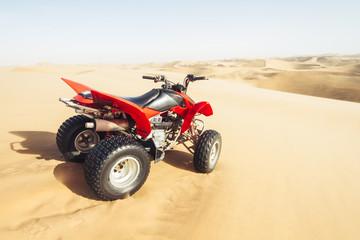 ATV on desert sand dunes landscape