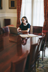 Young businesswoman working with laptop on a meeting room.