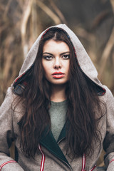 portrait of a hooded beautiful brunette woman
