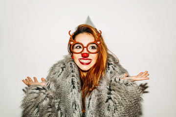 Young woman with deer glasses and nose posing.