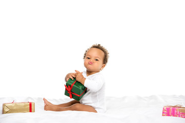 african american toddler with gifts