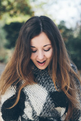 Happy young woman looking down