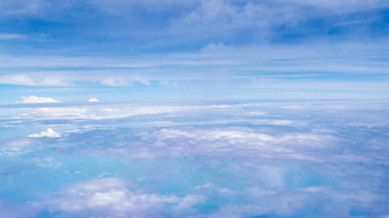 the view of blue sky and white cloud from the airplane window