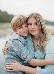 Mother and son sitting together and hugging