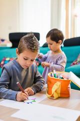 children doing homeworks at home