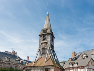 Bell tower of at Saint Catherine's Church in Honfleur, France. The tower is a famous landmark of the old medieval city near the Seine.