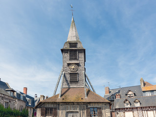 Clock tower of at Saint Catherine's Church in Honfleur, France. The tower is a famous landmark of the old medieval city near the Seine.