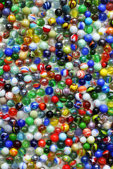 Colorful mix of used glass marbles