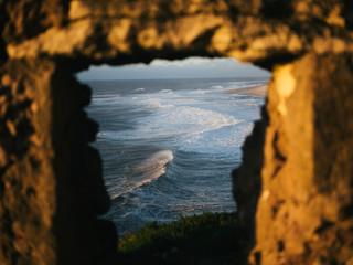 Waves in the ocean framed inside fortress window