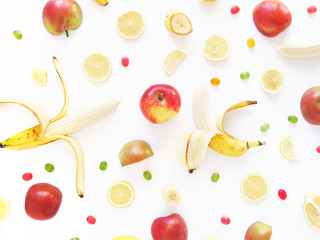 Composition of bananas, lemons and apples on a white background, flat layout, top view. Fruit background. Pattern of fruits.Food frame.