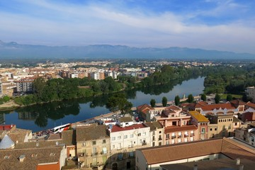 Tortosa, Catalonia, Spain skyline view over River Ebro with distant mountains