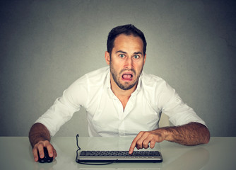 Confused upset man working on computer