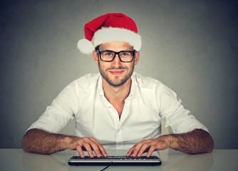 man using computer shopping online looking for a christmas gift.