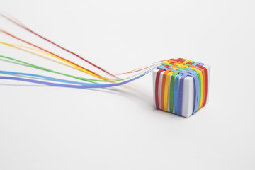 Woven rainbow paper covered cube