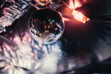 Disco ball hanging from the ceiling of a house party