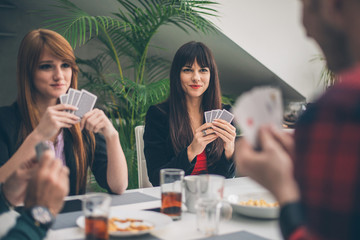 Group of People Playing Card Game